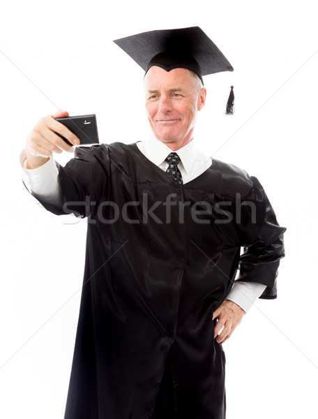 Senior male graduate taking picture of himself with a mobile pho Stock photo © bmonteny