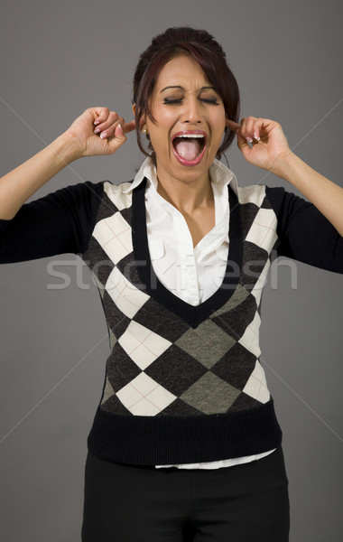 Indian businesswoman shouting with hands in ear Stock photo © bmonteny