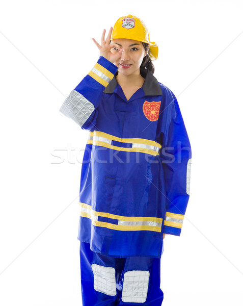 Stock photo: Lady firefighter showing ok sign