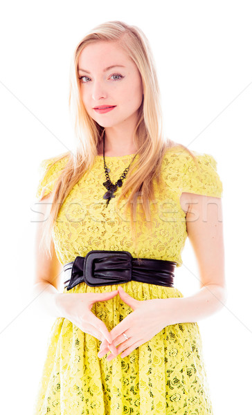 Beautiful young woman standing and making heart shape with her h Stock photo © bmonteny