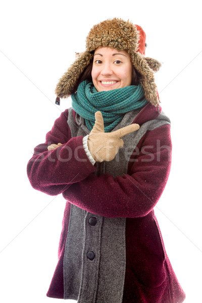 Young woman in warm clothing and pointing backward Stock photo © bmonteny