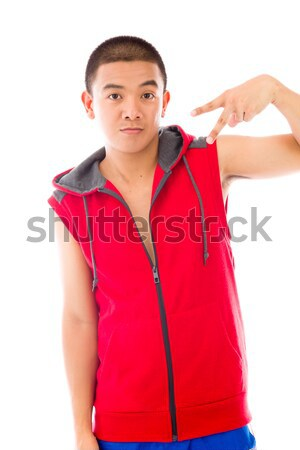 Indian young woman pointing finger upward Stock photo © bmonteny