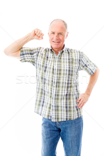 Senior man showing off his muscle Stock photo © bmonteny