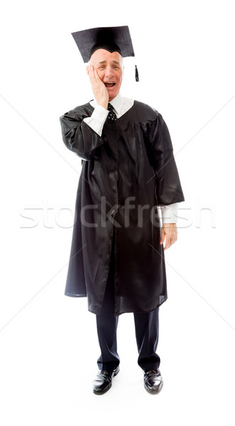 Excited senior male graduate holding his cheek with hand Stock photo © bmonteny