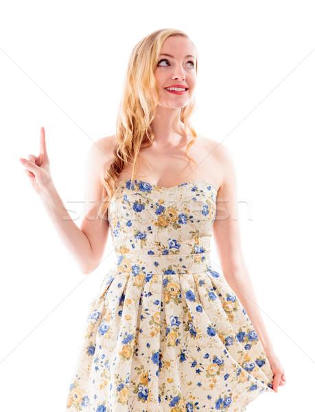 Stock photo: Beautiful young woman pointing upward