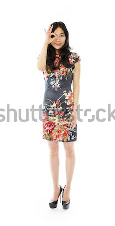 Asya genç kadın neden imzalamak ayakkabı Stok fotoğraf © bmonteny