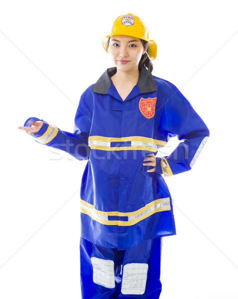 Lady firefighter presenting isolated on white background Stock photo © bmonteny
