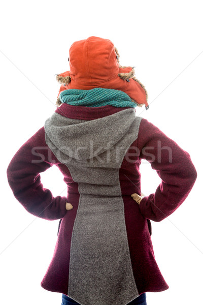 Rear view of a young woman in warm clothing and standing with ar Stock photo © bmonteny