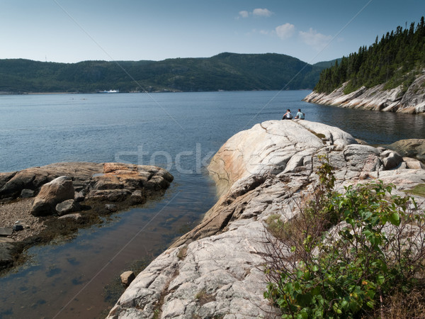 Two tourist sitting on rock at the riverside, Saint Lawrence Riv Stock photo © bmonteny