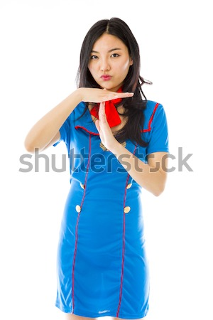 Asian air stewardess pointing finger to head Stock photo © bmonteny