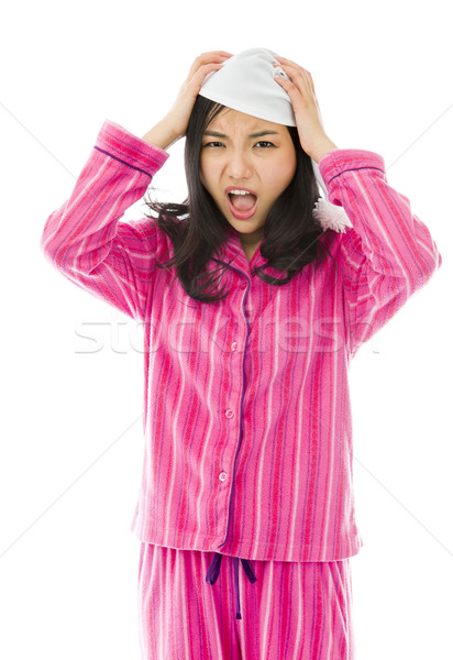 Young Asian woman pulling her hair and screaming in frustration Stock photo © bmonteny
