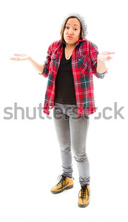 Young woman gesturing and shrugging Stock photo © bmonteny