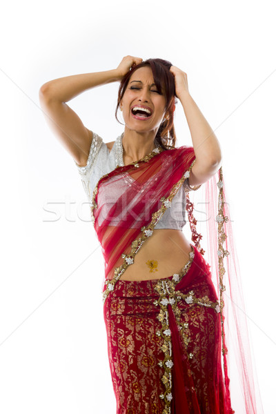 Young Indian woman pulling her hair and screaming in frustration Stock photo © bmonteny