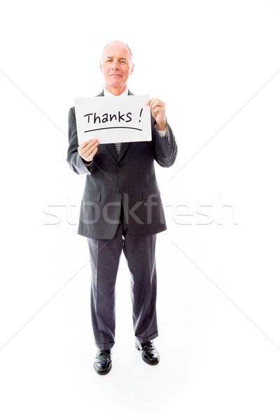 Businessman holding a message board with the text words 'Thanks' Stock photo © bmonteny