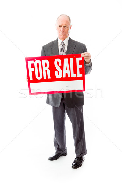 Businessman showing a for sale sign Stock photo © bmonteny