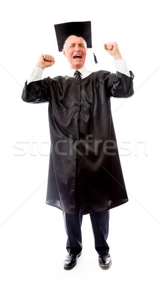 Senior mannelijke afgestudeerde vieren succes onderwijs Stockfoto © bmonteny