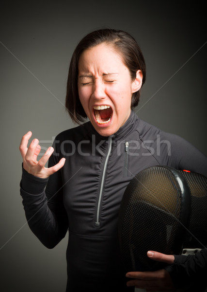 Female fencer shouting Stock photo © bmonteny