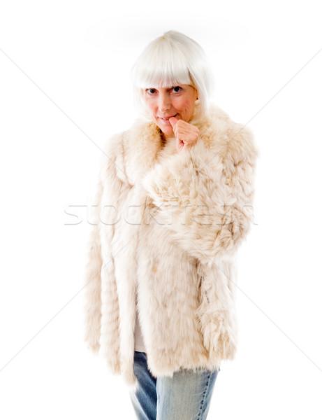 Idős nő harap szög portré fehér Stock fotó © bmonteny