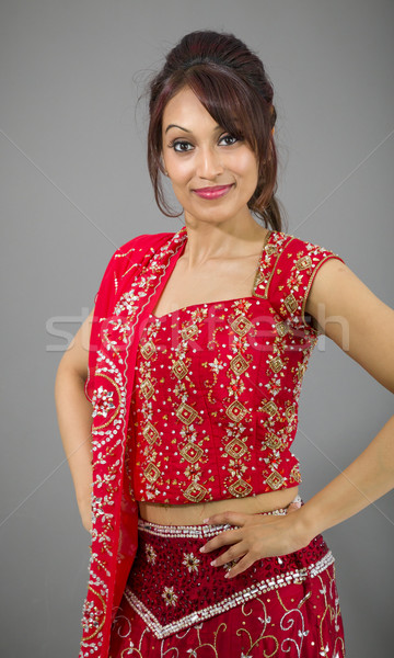 Young Indian woman standing with her arms akimbo Stock photo © bmonteny