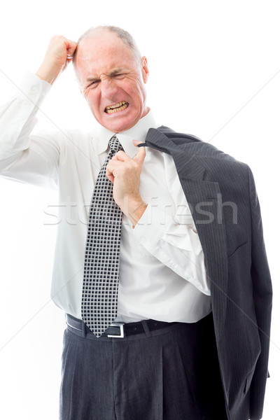 Businessman pulling his hair and screaming in frustration Stock photo © bmonteny