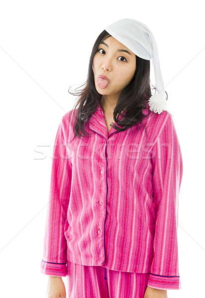 Young Asian woman sticking out her tongue Stock photo © bmonteny