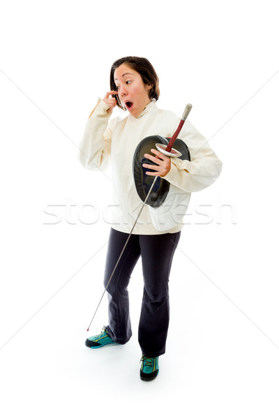 Female fencer standing with a holding mask and sword Stock photo © bmonteny