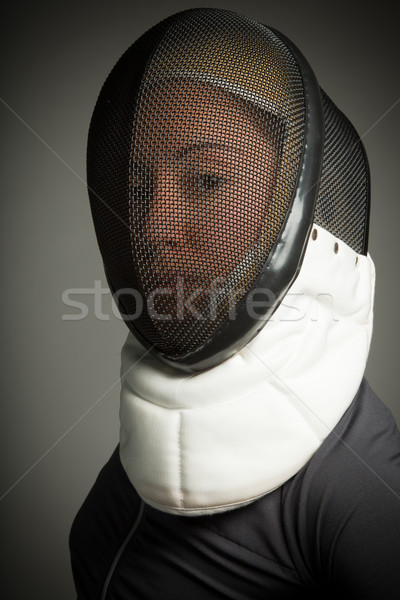 Close up of a female fencer in fencing mask Stock photo © bmonteny