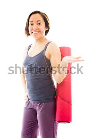 Young woman carrying exercising mat and celebrating success Stock photo © bmonteny