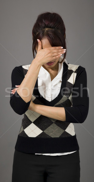 Indian businesswoman hiding her face Stock photo © bmonteny