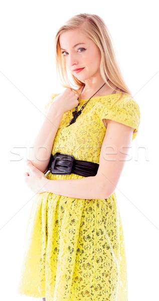 Gyönyörű fiatal nő áll portré ruha citromsárga Stock fotó © bmonteny