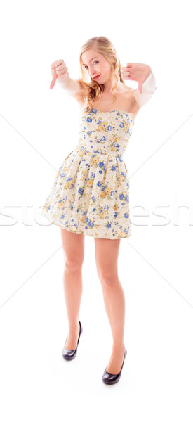 Young woman standing and showing thumbs down with both hands Stock photo © bmonteny