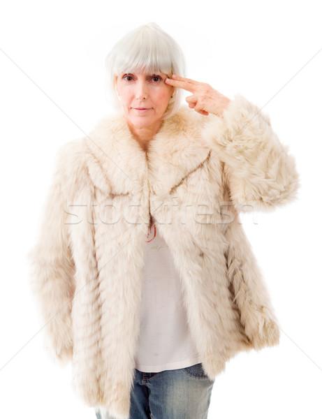 Idős nő tart ujj fej portré Stock fotó © bmonteny