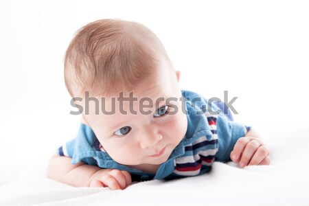 Close-up of a baby boy lying on the bed Stock photo © bmonteny