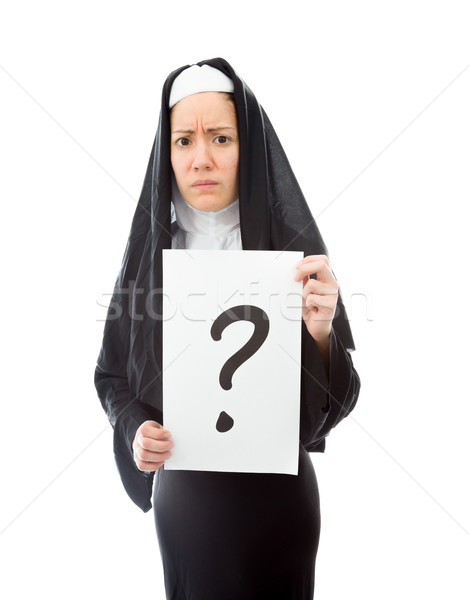 Young nun showing question mark on white background Stock photo © bmonteny