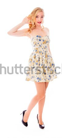 Beautiful young woman standing with her arm outstretched Stock photo © bmonteny