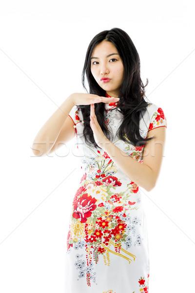 ázsiai fiatal nő mutat jel portré fehér Stock fotó © bmonteny