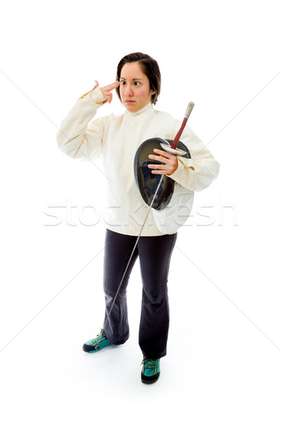 Female fencer making gun with hand pointed at head Stock photo © bmonteny
