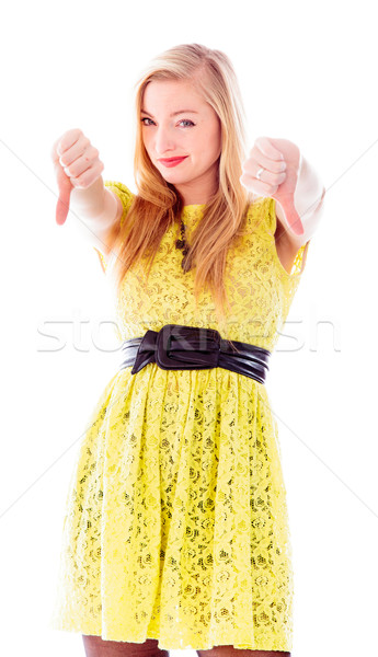 Young woman showing thumbs down sign with both hands Stock photo © bmonteny