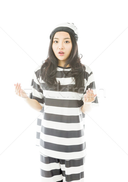 Young Asian woman looking shocked in prisoners uniform Stock photo © bmonteny