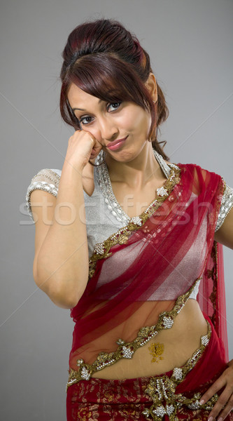 Sad young Indian woman standing with head in hands Stock photo © bmonteny