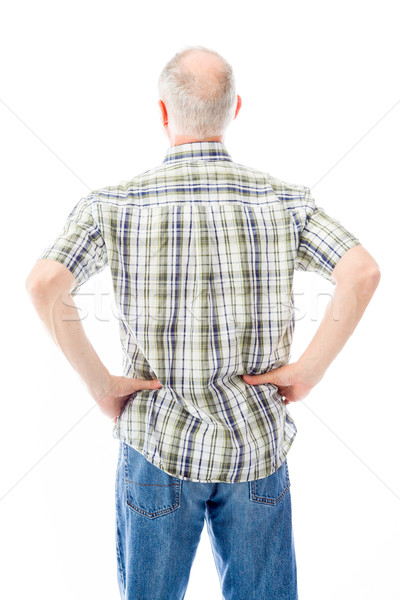 Rear view of a senior man standing with his arms akimbo Stock photo © bmonteny