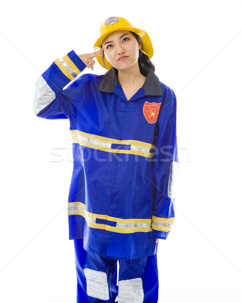 Lady firefighter pointing finger to head Stock photo © bmonteny