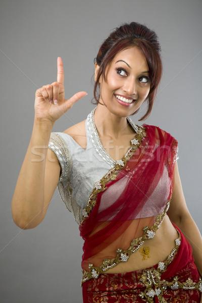 Jeunes indian femme pointant souriant adulte Photo stock © bmonteny
