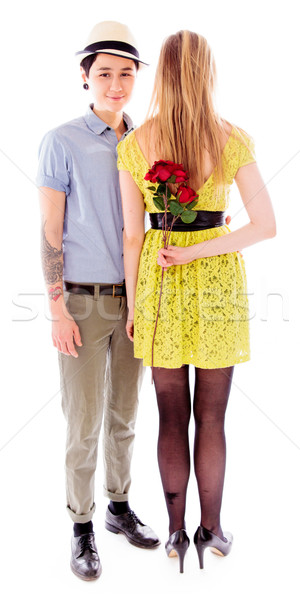 Woman hiding red rose to make surprise to friend Stock photo © bmonteny
