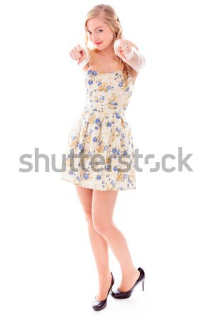 Side profile of a young woman standing with her arm outstretched Stock photo © bmonteny