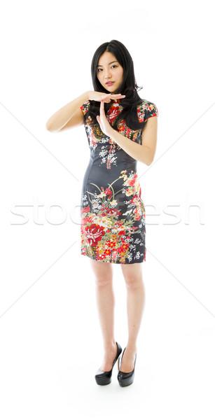 ázsiai fiatal nő mutat jel portré cipő Stock fotó © bmonteny