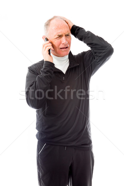 Senior man talking on a mobile phone and looking confused Stock photo © bmonteny
