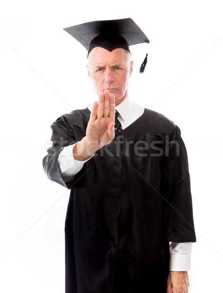Senior male graduate making stop gesture Stock photo © bmonteny