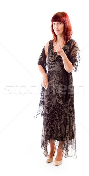 Mature woman pointing towards camera Stock photo © bmonteny
