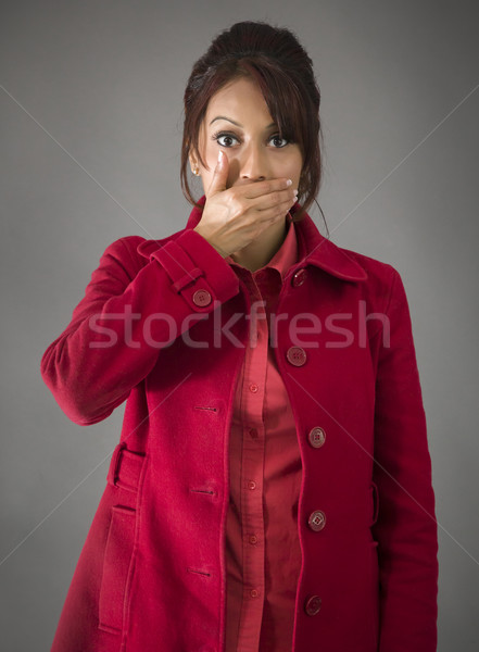 Indian young woman with hand over her mouth Stock photo © bmonteny